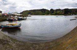 Puerto Montt. Chile-october 17, 2014: Fishermen working on the quay of the small harbor with fishermen and leisure boat at high tide, in Angelmo, tourist area Stock Image