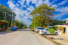 Puerto Morelos, Mexico - January 10, 2018: Beautiful outdoor view of some houses with many cars parked in the street of Stock Images