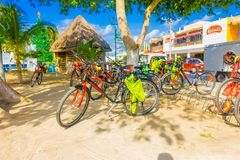 Puerto Morelos, Mexico - January 10, 2018: Outdoor view of many bicycles parked in a row woin a rent bikes in the. Streets of Puerto Morelos, Yucatan Peninsula royalty free stock images