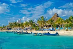 Puerto Morelos, Mexico - January 10, 2018: Outdoor view of many boats in a row in the water in Puerto Morelos beach