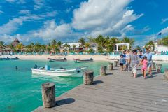Puerto Morelos, Mexico - January 10, 2018: Outdoor view of unidentified people walking at outdoors over a wooden pier in stock photos