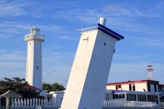 Puerto Morelos new and old inclined lighthouses. Mayan Riviera Mexico stock image