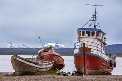 Puerto Natales - Patagonia - Chile. Old abandoned fishing boats near Puerto Natales in Patagonia in southern Chile, South America. Puerto Natales is located at Stock Photography