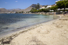 PUERTO POLLENSA, MALLORCA - 29 JULY 2015. People relaxing and e. Beautiful beach in Spain Stock Images