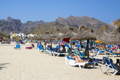 PUERTO POLLENSA, MALLORCA - 27 JULY 2015 Prople Relaxing on the. People relaxing on a beach stock image