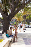 PUERTO POLLENSA, MALLORCA - 27 JULY 2015. A young woman applying. Young couple applying sun cream near beach stock photos