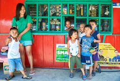 Young boys and a mother at a philippine neighborhood store royalty free stock photo
