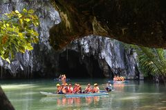 Underground river. PUERTO PRINCESA, PHILIPPINES - NOVEMBER 29, 2017: People ride the boats to underground river in Puerto Princesa, Philippines. Puerto Princesa Royalty Free Stock Photo