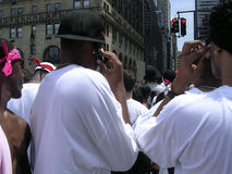 Puerto Rican Day Parade. Guys on cell phone royalty free stock photos
