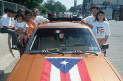 A Puerto Rican family with their flag draped car Stock Images