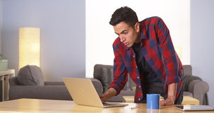 Puerto Rican man using laptop at desk Royalty Free Stock Photography