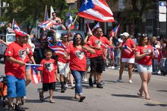 The Puerto Rican People`s Parade. Chicago, Illinois, USA - June 16, 2018: The Puerto Rican People`s Parade, Puerto Rican people carrying puerto rican flags royalty free stock photos