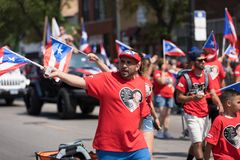 The Puerto Rican People`s Parade. Chicago, Illinois, USA - June 16, 2018: The Puerto Rican People`s Parade, Puerto Rican people carrying puerto rican flags royalty free stock photo