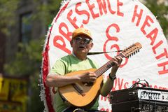The Puerto Rican People`s Parade. Chicago, Illinois, USA - June 16, 2018: The Puerto Rican People`s Parade, Puerto Rican man playing a guitar on top of a float stock image