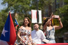 The Puerto Rican People`s Parade. Chicago, Illinois, USA - June 16, 2018: The Puerto Rican People`s Parade, Puerton rican people riding on cars celebrating with stock photos