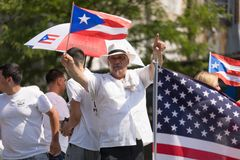 The Puerto Rican People`s Parade. Chicago, Illinois, USA - June 16, 2018: The Puerto Rican People`s Parade, Puerto Rican people on top of a float celebrating stock image