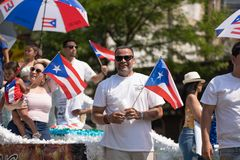 The Puerto Rican People`s Parade. Chicago, Illinois, USA - June 16, 2018: The Puerto Rican People`s Parade, Puerto Rican people on top of a float celebrating royalty free stock images
