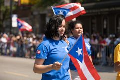 The Puerto Rican People`s Parade. Chicago, Illinois, USA - June 16, 2018: The Puerto Rican People`s Parade, Puerto rican woman waving the puerto rican flag going royalty free stock image