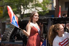 The Puerto Rican People`s Parade. Chicago, Illinois, USA - June 16, 2018: The Puerto Rican People`s Parade, Puerto rican woman waving the puerto rican flag going stock image