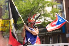 The Puerto Rican People`s Parade. Chicago, Illinois, USA - June 16, 2018: The Puerto Rican People`s Parade, woman wearing a traditional mask from puerto rico royalty free stock photography
