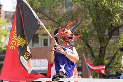 The Puerto Rican People`s Parade. Chicago, Illinois, USA - June 16, 2018: The Puerto Rican People`s Parade, woman wearing a traditional mask from puerto rico stock photo
