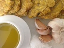 Puerto Rican tostones and ingredients Royalty Free Stock Images