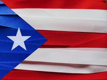 Puerto Rico flag or banner. Made with red, blue and white ribbons Stock Photos