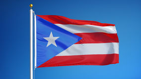 Puerto Rico flag in slow motion seamlessly looped with alpha. Puerto Rico flag waving in slow motion against clean blue sky, seamlessly looped, close up stock video footage