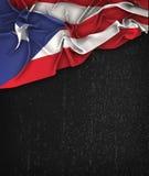 Puerto Rico Flag Vintage en una pizarra del negro del Grunge imagen de archivo libre de regalías