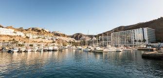 Puerto Rico, Gran Canaria - December 12 2017: Marina of Puerto Rico, a very popular travel destination. Sailboats in the Stock Photos