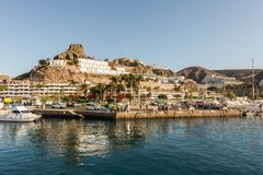 Puerto Rico, Gran Canaria - December 12 2017: Marina of Puerto Rico, a very popular travel destination. Boats, cars and Stock Images