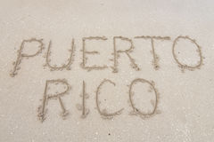 Puerto Rico. Letters PUERTO RICO carved in soft white sand of tropical beach in Puerto Rico stock photos