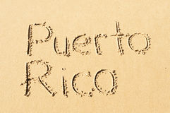 Puerto Rico. A picture of the word Puetro Rico  drawn in the sand Royalty Free Stock Photos
