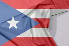 Puerto Rico tkaniny flaga zagniecenie z biel przestrzenią i krepa zdjęcie royalty free