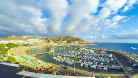 Puerto Rico town, famous tourist resort on Gran Canaria island, Spain. Panoramic aerial view of sea port and small bay of Puerto Rico de Gran Canaria holiday stock video footage