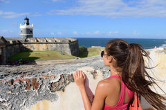 Puerto Rico travel tourist woman in San Juan. Looking down at the fort Castillo San Felipe Del Morro, famous attraction of Old San Juan city in Puerto Rico Royalty Free Stock Photography