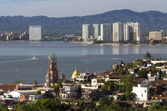 Puerto Vallarta Landscape. Puerto Vallarta old town and the new  area in the foreground Royalty Free Stock Image