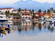 Puerto Vallarta marina, harbour, port in Jalisco, Mexico. With houses shops and boats royalty free stock photo