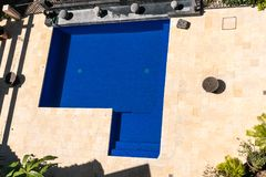 A view of an outdoor pool in luxury setting. royalty free stock photography