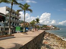Puerto Vallarta Waterfront. Photo of the Malecon in Puerto Vallarta Mexico.  This sidewalk is in the center of town and provides a view of Banderas bay Royalty Free Stock Image