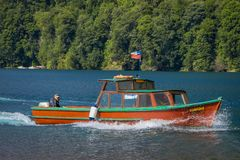 PUERTO VARAS, CHILE, SEPTEMBER, 23, 2018: Huge boat with tourists around the Lake Todos Los Santos, Region in Chile. In gorgeous sunny day royalty free stock images