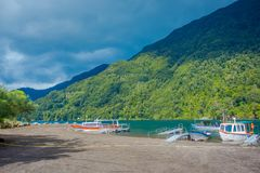 PUERTO VARAS, CHILE, SEPTEMBER, 23, 2018: Outdoor view of boats on the shore of Lake Todos Los Santos, Region in Chile.  royalty free stock photography