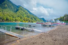 PUERTO VARAS, CHILE, SEPTEMBER, 23, 2018: Outdoor view of boats on the shore of Lake Todos Los Santos, Region in Chile.  royalty free stock image