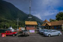 PUERTO VARAS, CHILE, SEPTEMBER, 23, 2018: Outdoor view of house buildings and some cars parked in the shore of National. Park Vicente Perez Rosales in front of royalty free stock photo
