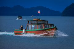 PUERTO VARAS, CHILE, SEPTEMBER, 23, 2018: Outdoor view of huge boat with tourists around the Lake Todos Los Santos. Region in Chile in gorgeous day stock images