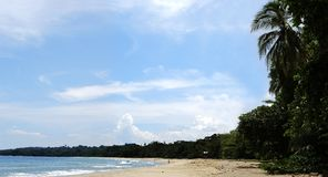 Puerto Viejo Beach. Panoramic view of picturesque quiet beach in Puerto Viejo resort town, Costa Rica royalty free stock photo