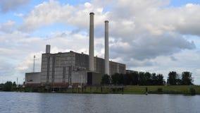 Puerto y central eléctrica foto de archivo libre de regalías