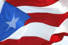 Puertorrican Waving Flag. Closeup image of the Puertorrican (Puerto Rico) Flag Waving over a clear blue sky Royalty Free Stock Image