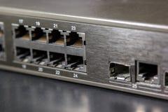 Puertos Rj45 y puerto gbic en panel de delante de un interruptor Fotografía de archivo libre de regalías