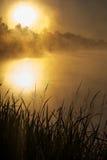 Puesta del sol agradable sobre el lago Fotografía de archivo libre de regalías
